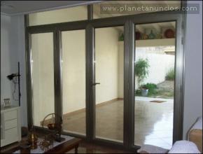 Puerta bronce de 4 hojas plegable carpinteria de - Puertas plegables bricomart ...